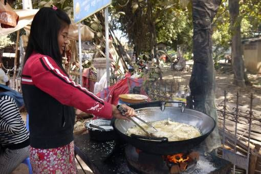 Cambodian Woman Cooking Banana Fritters