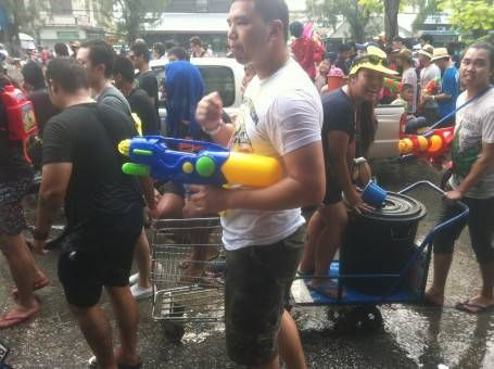 Thai People with Water Guns Celebrating Songkran