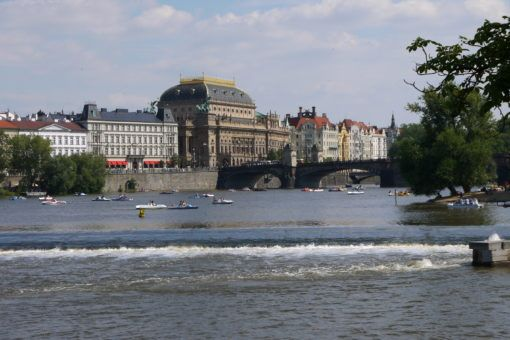 Riverbank view of the Charles Bridge in Prague