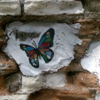 Butterfly and smiley face street art in Chiang Mai