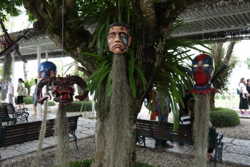 Terminator Head hanging from a tree at the White Temple in Chiang Rai