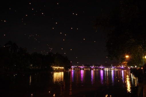 Paper lanterns in the sky during Yi Peng festival in Chiang Mai