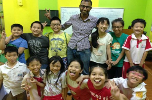 Non native English teacher Venkat with his students in Vietnam