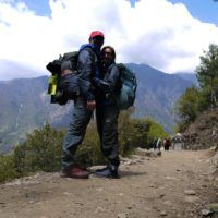 Us with our backpacks starting the Everest Base Camp Trek in Nepal