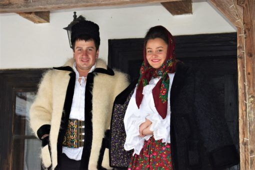 Locals wearing traditional Romanian costumes
