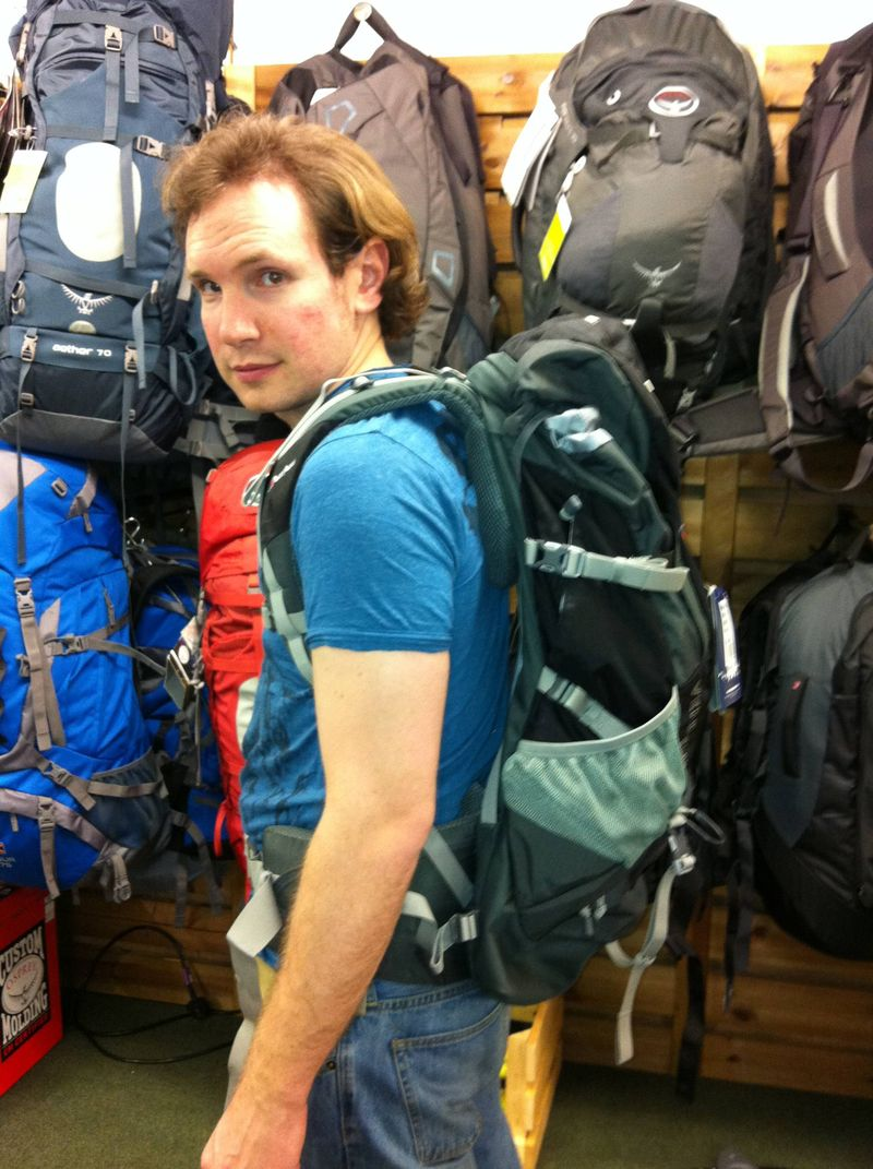 Andrew trying on backpacks for our round the world trip