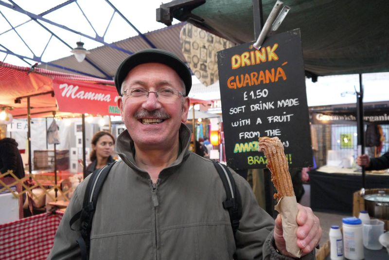 Andrew's dad enjoying Churros at Greenwich Food Market