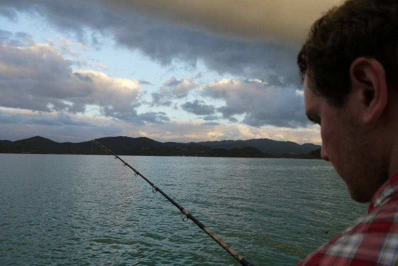 Andrew fishing at dusk in the Bay of Islands