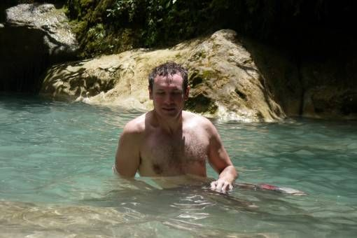Andrew Bitten by Fish at Erawan Waterfall