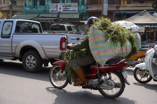 Motorbike Loaded with Bags in Asia