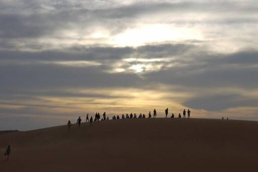 Watching sunset on the Red Sand Dunes