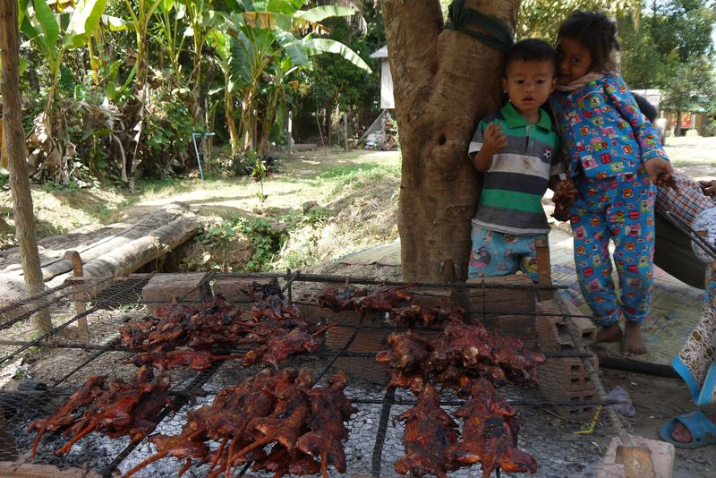Kids Eating BBQ Rat in Cambodia