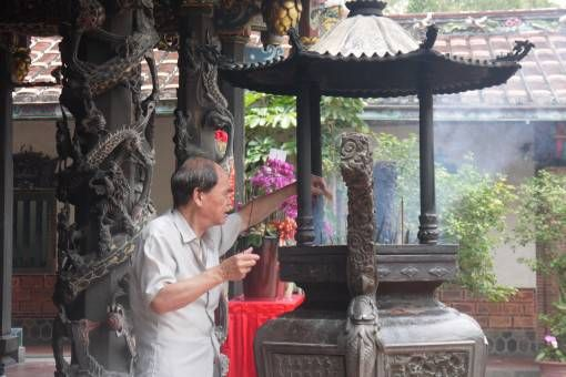 Lighting Incense at a temple in Taipei