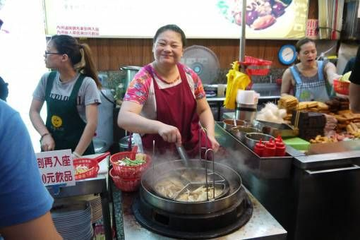 Woman cooking food in Taipei