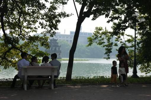 Locals and tourists enjoying Hoan Kiem Lake in Hanoi's Old Quarter