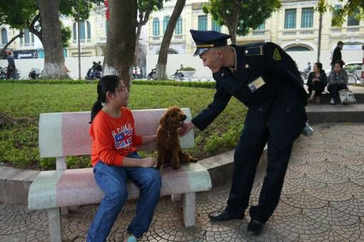 Police man and dog at Hoan Kiem Lake in Hanoi