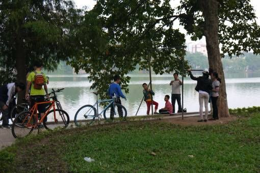 Children Playing by Hoan Kiem Lake in Vietnam