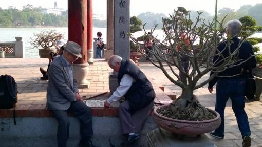 Men playing checkers at Ngoc Son Temple in Hanoi's Old Quarter
