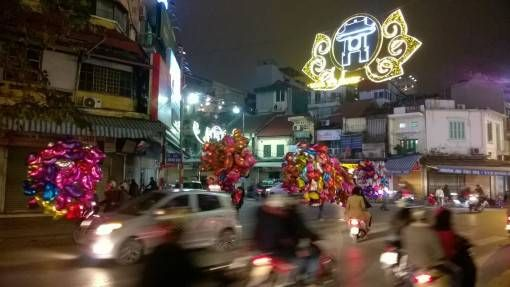 Life in Hanoi: Balloons on a Hanoi Street at Night