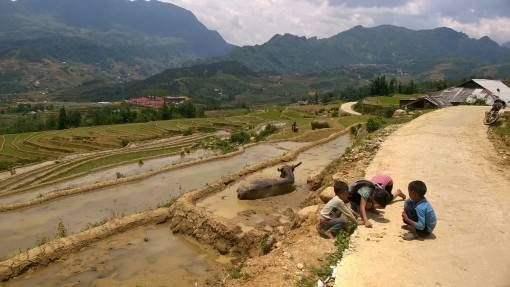 Local children playing by the roadside in Sapa, Vietnam