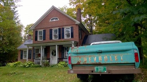 A beat-up Chevy in a Vermont driveway