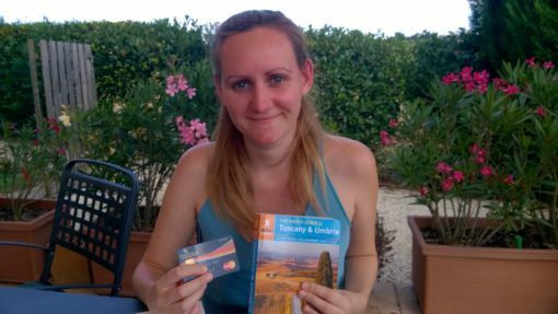 Amy with a WeSwap Card and Guide Book for Italy