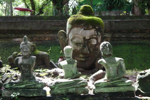Stone Buddha Statues in a garden at Wat Umong Temple in Chiang Mai
