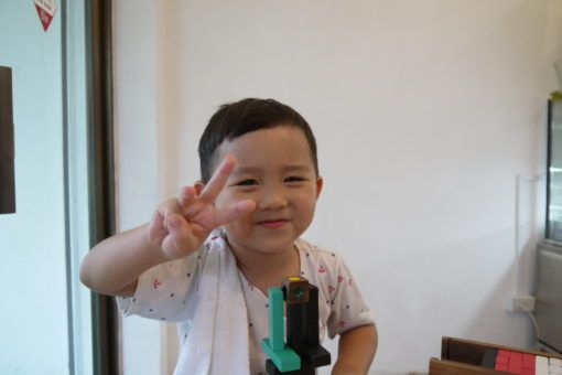 Thai Boy making a Peace Sign