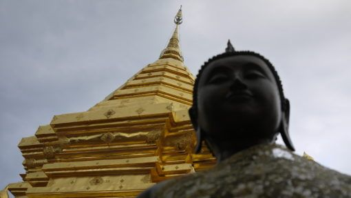 Close up of Buddha statue and pagoda at Wat Phra That Doi Suthep, Thailand