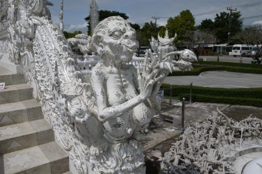 Statue on the Cycle of Rebirth Bridge at the White Temple