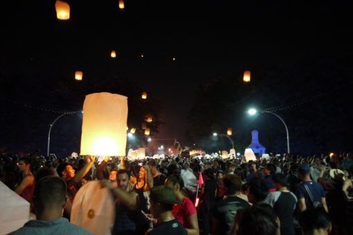 People releasing paper lanterns on Nawarat Bridge in Chiang Mai during the Yi Peng festival