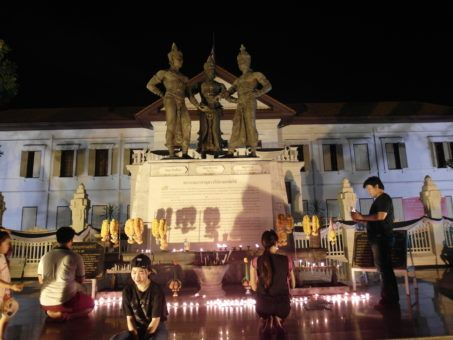 The Three Kings Monument in Chiang Mai with candles at the Yi Peng Lantern festival