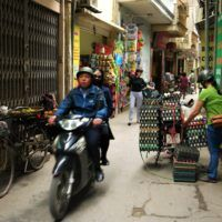 Motorbiking through Hanoi's narrow streets