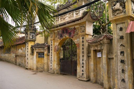 Pastel crumbling temple entrance in Hanoi