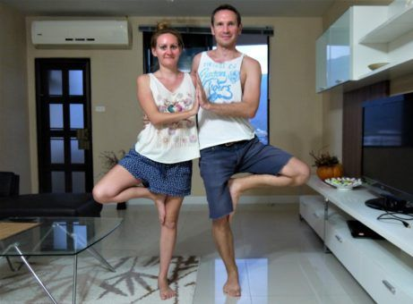 Us practising yoga - the couples tree pose