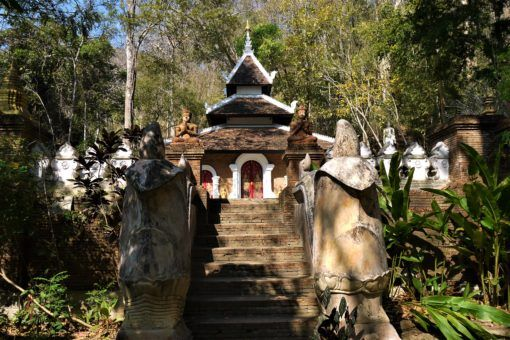 Buddhist statues and staircases at Wat Pha Lat, Chiang Mai