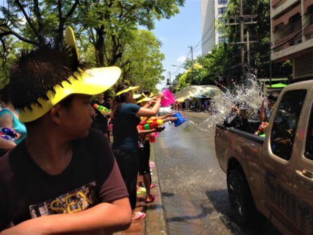 Boy preparing to attack during the Songkran festival in Chiang Mai