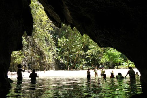 Emerging from the Emerald Cave on the Koh Lanta Four Islands boat tour, Thailand
