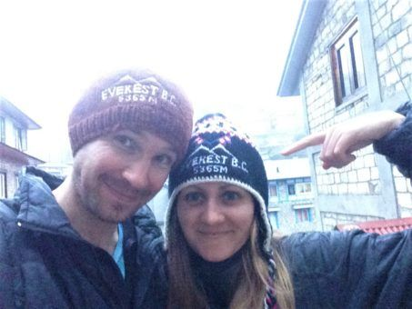 Us wearing Everest Base Camp souvenir hats