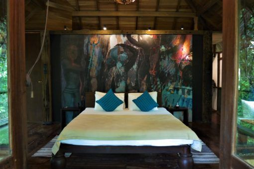 The wonderful bedroom at Diyabubula with Laki's artwork