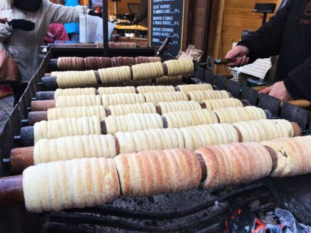 The Trdelnik or chimney cakes cooking at the Christmas Markets in Prague