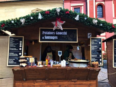 Food stall selling potatoes and sausages at the Prague Xmas Markets 2017