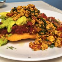 Colombian arepa with tofu scramble and avocado