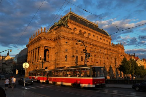 A tram passes the National Theatre in Prague