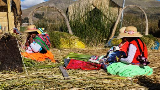 Neon clothed Uros women on the Uros floating Islands, Lake Titicaca