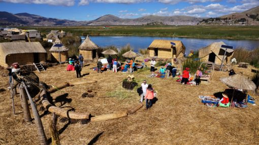 A typical Uros Floating Island on Lake Titicaca, Peru