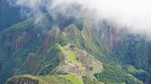 The clouds quickly rolling in over Machu {picchu, Peru