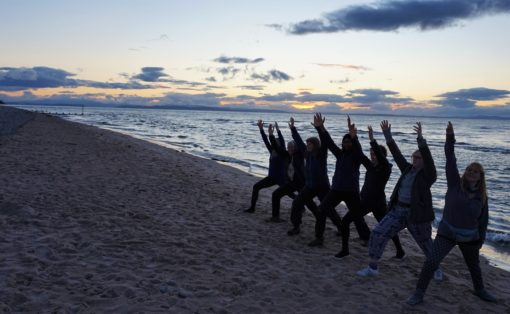 Yoga pose on the sand at Findhorn Bay, Scotland