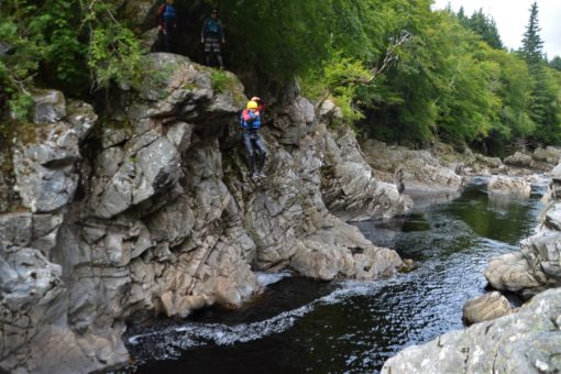 Andrew jumping off an 8-metre cliff into the river in Scotland