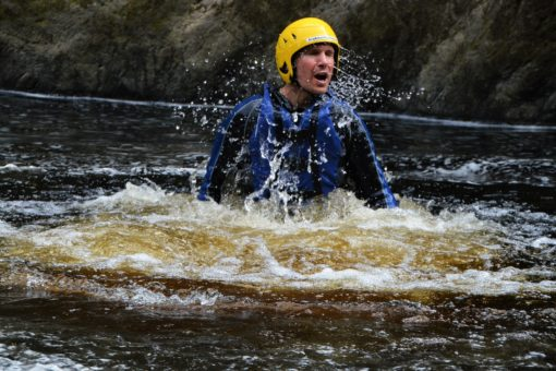 Andrew jumping into the river on a trip with ACE Adventures in Moray, Scotland
